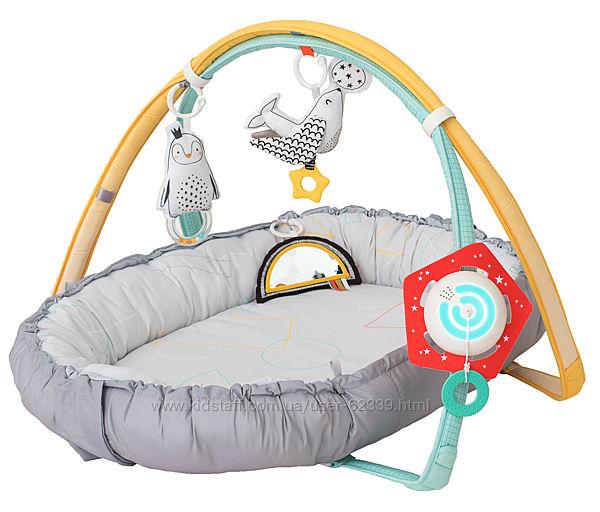 Развивающий музыкальный кокон с дугами 4в1 Уютное гнездышко Taf Toys