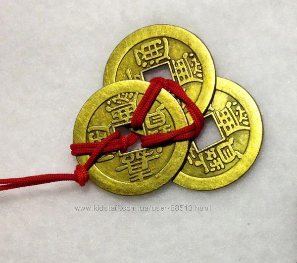 Три счастливые монеты  талисман для привлечения денежной удачи