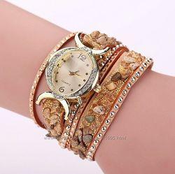 Часы-браслет с ослепительными камнями
