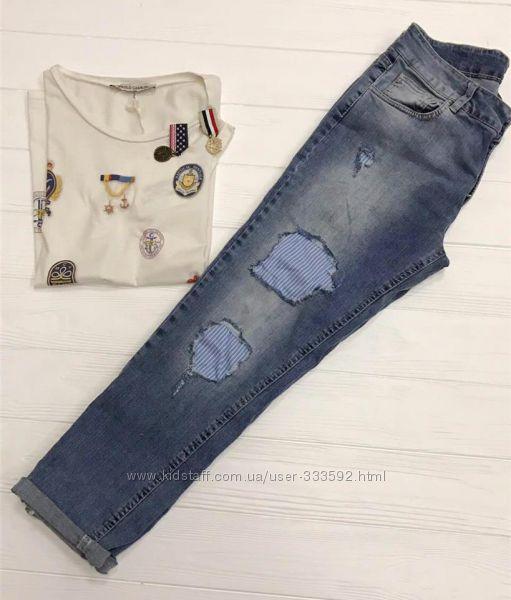 Женские рваные джинсы голубого цвета с контрастными вставками, Италия