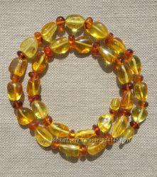 Яркие янтарны бусы из натурального полированного янтаря