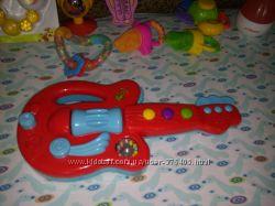 Музыкальная развивающая гитара Tesco