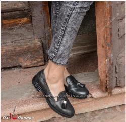 Стильные качественные кожанные туфли.