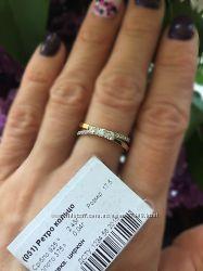 Серебряное кольцо с золотыми пластинами.