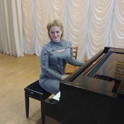 Преподаватель игры на фортепиано