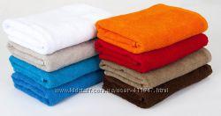 Махровые однотонные полотенца