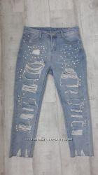 Модные рваные джинсы бойфренды
