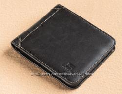 Стильный черный кожаный кошелек в наличии