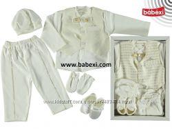 Нарядные комплекты новорожденным
