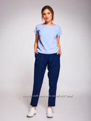 Брюки синего цвета с карманами