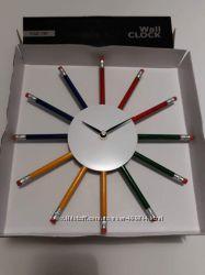 Часы настенные с карандашами.