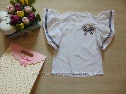 Блузка нарядная  с рюшами на плечах