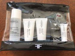 Набор мини продуктов Filorga в косметичке