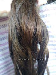 Натуральные пряди волос на заколках .