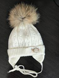 Утепленная шапка с натуральным помпоном