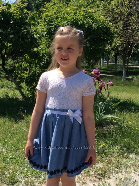 Симпатичное платьице  в отличном состоянии на 5-6 лет