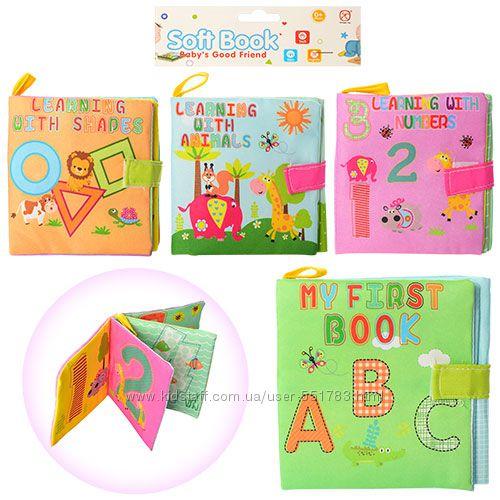Кубики для купания и мягкие тканевые книжки.