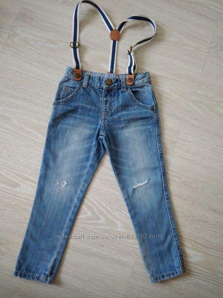 модные рваные джинсы  MOTHERCARE