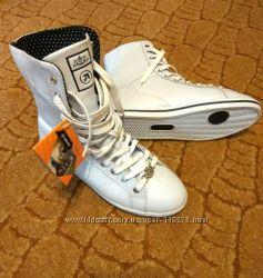 Нові стильні білі кросівки Restime
