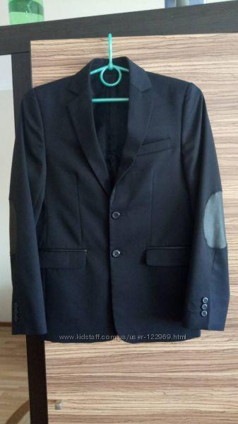 Продам красивенный пиджак турецкого производства на мальчика 11-13 лет