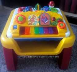 Фирменный развивающий столик для малышей