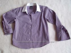 Рубашка сиреневая, длина 47 см.