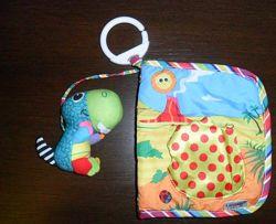 Lamaze Развивающая игрушка мягкая яркая книжка из ткани шуршит пищит