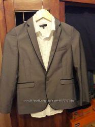 Продам шикарный фирменный костюм