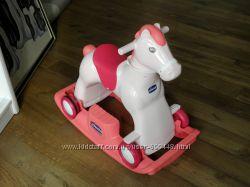 Детская игрушка лошадка со звуком фирмы Chicco для катания верхом