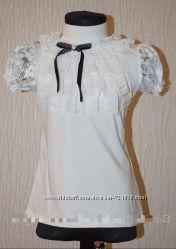 Гольф-блузка нарядная подойдет в школу