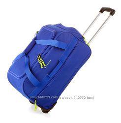 Брендовая испанская дорожная сумка на колесах легкого синего цвета