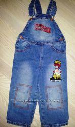 Модный джинсовый комбинезон Gloria Jeans .