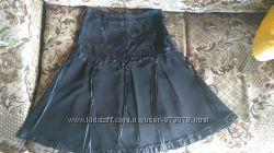 Черная красивая женская юбка миди расклешенная