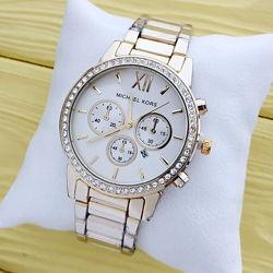 Женские наручные часы Michael Kors золотого цвета черный и белый циферблат