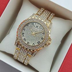 Яркие женские часы Rolex с полностью в камушках - золото, серебро