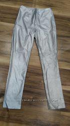 Серебристые штаны 44 размера