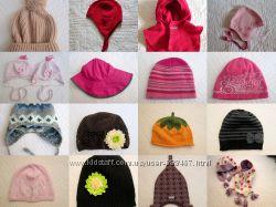 Разные шапки шлемы манишки для девочки