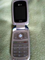 мобильный телефон LG c наушниками