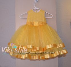 Пышное желтое платье с лентами