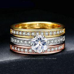 Тройное кольцо с цирконом. Позолота