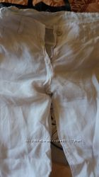 Женские белые брючки из льна на манжете