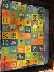 Развивающий коврик для малыша с погремушками. Съемный чехол на липучках