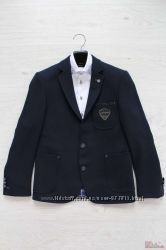 Пиджак для мальчика трикотажный в рубчик Herdal