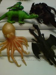 Фигурки драконов и осьминога