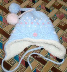 Тёплая шапка на овчине