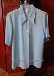 Новенька блузка-рубашка голубого кольору