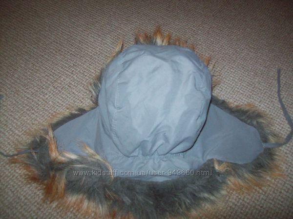 очень теплая шапка состояния нового на 6-10 лет