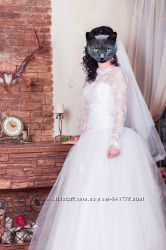 Свадебное платье с длинным рукавом.