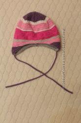 Продам зимнюю шапочку на девочку