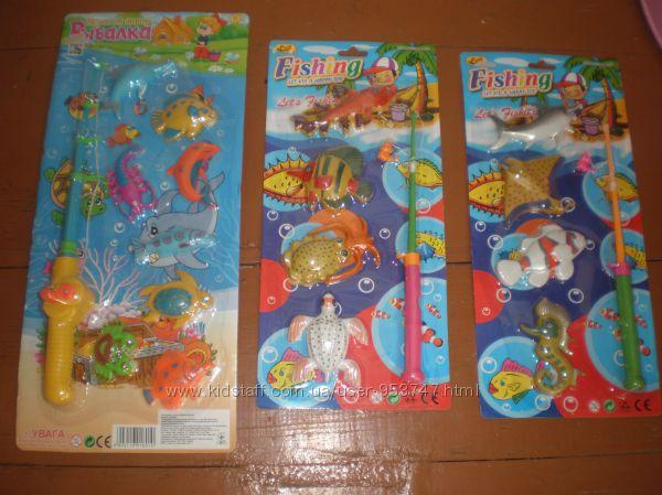 Вудочка з рибками, пірамідки, піаніно, ляльки, коляска, песики, боулінг